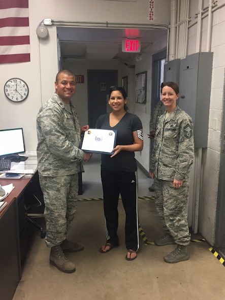 U.S. Air Force Tech. Sgt. Rachel Merriman, 355th Equipment Maintenance Squadron nondestructive inspection craftsman, receives her promotion certificate at Davis-Monthan Air Force Base, Ariz., April 19, 2017. Merriman was hand-selected by her leadership to be promoted through the Stripes for Exceptional Performers program. (courtesy photo)