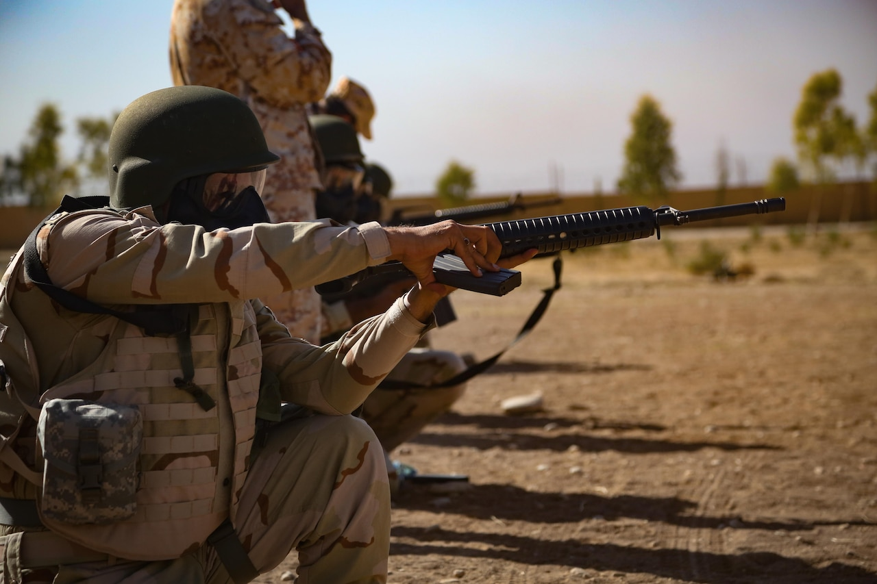 A Peshmerga soldier loads his M16 rifle during a chemical, biological, radiological and nuclear defense class taught by Italian trainers at Bnaslawa, Iraq, Sept. 21, 2016. This training is part of Combined Joint Task Force Operation Inherent Resolve's mission to increase the security capacity of local forces fighting the Islamic State of Iraq and Syria. DoD photo by Army Sgt. Lisa Soy
