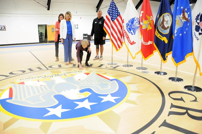 During the re-opening ceremony for the Col. Jack H. Griffith Jr. Memorial Field House on Joint Base McGuire-Dix-Lakehurst, New Jersey, Griffith's widow Bonnie admires the newly painted center court as daughters Barb and Megan look on along with Mark Smith, Griffith Field House fitness director. The field house re-opened May 5 following a 5-month, $750,000 transformation. In addition to receiving a new gym floor and running track, the field house now features energy-efficient lighting and is compliant with the Americans with Disabilities Act. Col. Griffith served as Fort Dix chief of staff from March 1984 until his death from cancer in December 1986. He was commissioned as an Infantry officer through the Reserve Officers' Training Corps at the University of Virginia, and was a graduate of the Army War College. He served two tours of duty in Vietnam where he was wounded in combat, and served in many other assignments around the world during his 26-year career.