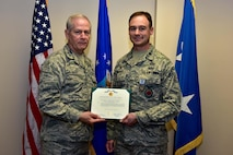 U.S. Air Force Maj. Gen. Mark H. Berry, The Adjutant General Arkansas National Guard, presents the U.S. Army Achievement Medal to Lt. Col. Daniel Werner, 19th Civil Engineer Squadron commander, May 5, 2017 at Little Rock Air Force base, Ark.  The EOD team responded to a call Feb. 22, 2017, to Mulberry, Ark. to assist the Army National Guard by defusing a spilt load of explosive devices that shut down Interstate 40 east and west bound.  (U.S. Air Force photo by Staff Sgt. Jeremy McGuffin)