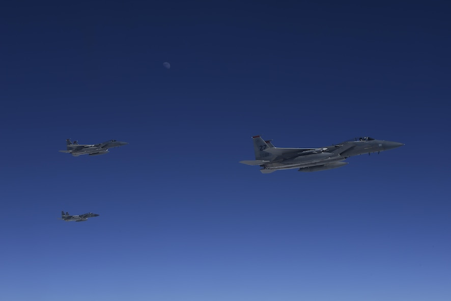 Three U.S. Air Force F-15C Eagles stage on the left side of a KC-10 Extender from the 9th Air Refueling Squadron based out of Travis Air Force Base, Calif., to refuel in-flight during exercise Northern Edge 2017, May 4, 2017. NE17 is Alaska's premier joint training exercise designed to practice operations, techniques and procedures, as well as enhance interoperability among the services.