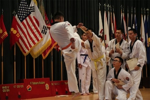 Korean Augmentation to the United States soldiers demonstrate their taekwondo skills during the Asian American and Pacific Islander Heritage Month observance at Camp Carroll in Waegwan, South Korea, May 4, 2017. Army photo by Cpl. Sin Jae-Hyung