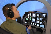 U.S. Air Force Tech. Sgt. Mike, Enlisted Pilot Initial Class student, operates the controls of a T-6 Texan II aircraft simulator, May 4, 2017 at Joint Base San Antonio-Randolph. Mike is assigned to Undergraduate Remotely Piloted Training Class 17-10 with the 558th Flying Training Squadron, and is one of the first three enlisted Airmen to graduate from the course, making him on of the service's first enlisted pilots since 1961. (U.S. Air Force photo by Joel Martinez)