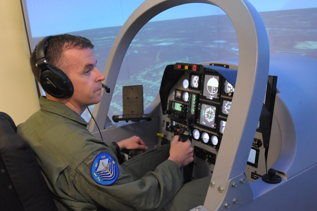 U.S. Air Force Master Sgt. Mike, one of the first Enlisted Pilot Initial Class students, operates flight controls of a T-6 Texan II simulator during the 558th Flying Training Squadron's Remotely Piloted Aircraft Fundamentals Course at Joint Base San Antonio-Randolph, Texas, May 4, 2017. Mike is one of the first three enlisted Airmen to graduate from the course, making him one of the service's first enlisted pilots since 1961. (U.S. Air Force photo by Joel Martinez)