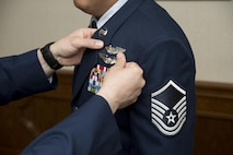 U.S. Air Force Master Sgt. Alex, Enlisted Pilot Initial Class student, has his wings pinned on during graduation from the 558th Flying Training Squadron's Remotely Piloted Aircraft Fundamentals Course May 5, 2017, at Joint Base San Antonio-Randolph, Texas.  Alex is one of the first three enlisted Airmen to graduate from the course, making him one of the service's first enlisted pilots since 1961. (U.S. Air Force Photo by Melissa Peterson)