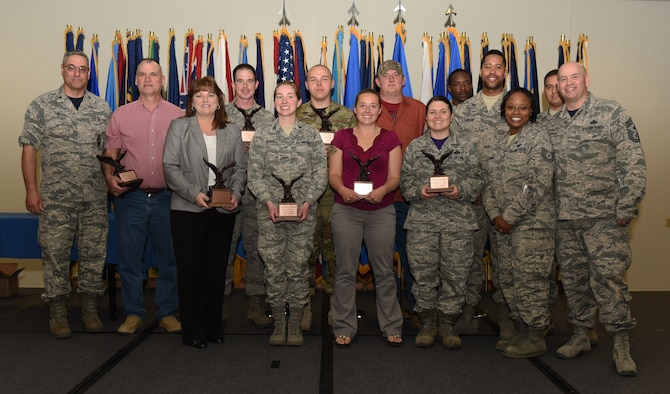 Col. Stephen Kravitsky, 90th Missile Wing commander, and Chief Master Sgt. Jeffery Steagall, 90th Missile Wing command chief, pose with the wing's first quarter award winners at F.E. Warren Air Force Base, Wyo., May 5, 2017. The wing held a celebration for all the nominees and presented the awards to the winners during a ceremony. (U.S. Air Force photo by Airman 1st Class Breanna Carter)