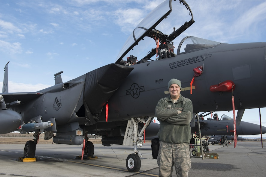 EIELSON AIR FORCE BASE, Alaska – U.S. Air Force Airman 1st Class Ryan Landrum, a 335th Aircraft Maintenance Unit weapons load crew member assigned to Seymour Johnson Air Force Base, N.C., poses for a photo in front of an F-15E Strike Eagle dual-role fighter aircraft from the 335th Fighter Squadron, May 4, 2017 during NORTHERN EDGE 2017 (NE17), at Eielson Air Force Base, Alaska. NE17 is Alaska's premier joint training exercise designed to practice operations, techniques and procedures as well as enhance interoperability among the services. Thousands of participants from all the services, Airmen, Soldiers, Sailors, Marines and Coast Guardsmen from active duty, Reserve and National Guard units are involved. (U.S. Air Force photo/Staff Sgt. Ashley Nicole Taylor)
