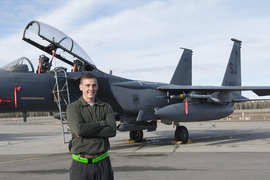 EIELSON AIR FORCE BASE, Alaska – U.S. Air Force Staff Sgt. Ryan Merritt, a 335th Aircraft Maintenance Unit crew chief assigned to Seymour Johnson Air Force Base, N.C., poses for a photo in front of an F-15E Strike Eagle dual-role fighter aircraft from the 335th Fighter Squadron, May 4, 2017, during NORTHERN EDGE 2017 (NE17), at Eielson Air Force Base, Alaska. NE17 is Alaska's premier joint training exercise designed to practice operations, techniques and procedures as well as enhance interoperability among the services. Thousands of participants from all the services, Airmen, Soldiers, Sailors, Marines and Coast Guardsmen from active duty, Reserve and National Guard units are involved. (U.S. Air Force photo/Staff Sgt. Ashley Nicole Taylor)