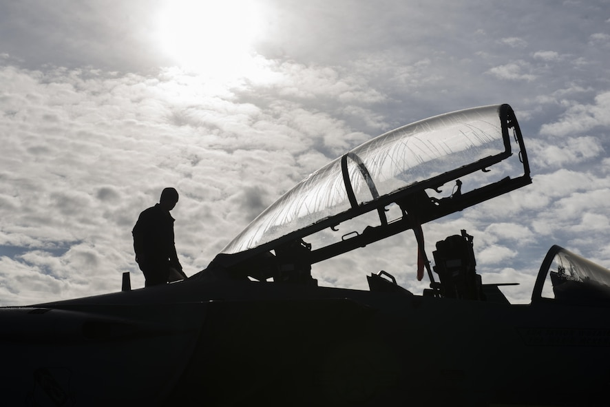EIELSON AIR FORCE BASE, Alaska – U.S. Air Force Staff Sgt. Brandon Coffman, a 335th Aircraft Maintenance Unit crew chief assigned to Seymour Johnson Air Force Base, N.C., performs pre-flight inspections on an F-15E Strike Eagle dual-role fighter aircraft from the 335th Fighter Squadron, May 4, 2017, during NORTHERN EDGE 2017 (NE17), at Eielson Air Force Base, Alaska. NE17 is Alaska's premier joint training exercise designed to practice operations, techniques and procedures as well as enhance interoperability among the services. Thousands of participants from all the services, Airmen, Soldiers, Sailors, Marines and Coast Guardsmen from active duty, Reserve and National Guard units are involved. (U.S. Air Force photo/Staff Sgt. Ashley Nicole Taylor)