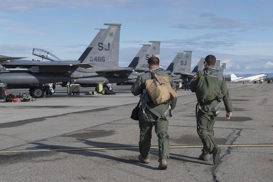 EIELSON AIR FORCE BASE, Alaska – U.S. Air Force F-15E Strike Eagle dual-role fighter aircraft pilots assigned to the 335th Fighter Squadron, Seymour Johnson Air Force Base, N.C., step to their jet and prepare for pre-flight inspections, May 4, 2017, during NORTHERN EDGE 2017 (NE17), at Eielson Air Force Base, Alaska. NE17 is Alaska's premier joint training exercise designed to practice operations, techniques and procedures as well as enhance interoperability among the services. Thousands of participants from all the services, Airmen, Soldiers, Sailors, Marines and Coast Guardsmen from active duty, Reserve and National Guard units are involved. (U.S. Air Force photo/Staff Sgt. Ashley Nicole Taylor)