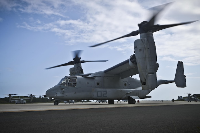 """An MV-22B Osprey aircraft with Marine Medium Tiltrotor Squadron (VMM) 268, 1st Marine Aircraft Wing, also known as the """"Red Dragons,"""" prepares to depart from Marine Corps Base Hawaii, April 19, 2017, to begin a deployment to Australia in support of Marine Rotational Force – Darwin. This marks the first trans-Pacific flight from Hawaii to Australia for the aircraft and the first deployment for VMM-268 since the squadron moved from MCAS Miramar, California, to Hawaii. (U.S. Marine Corps photo by Cpl. Aaron S. Patterson)"""