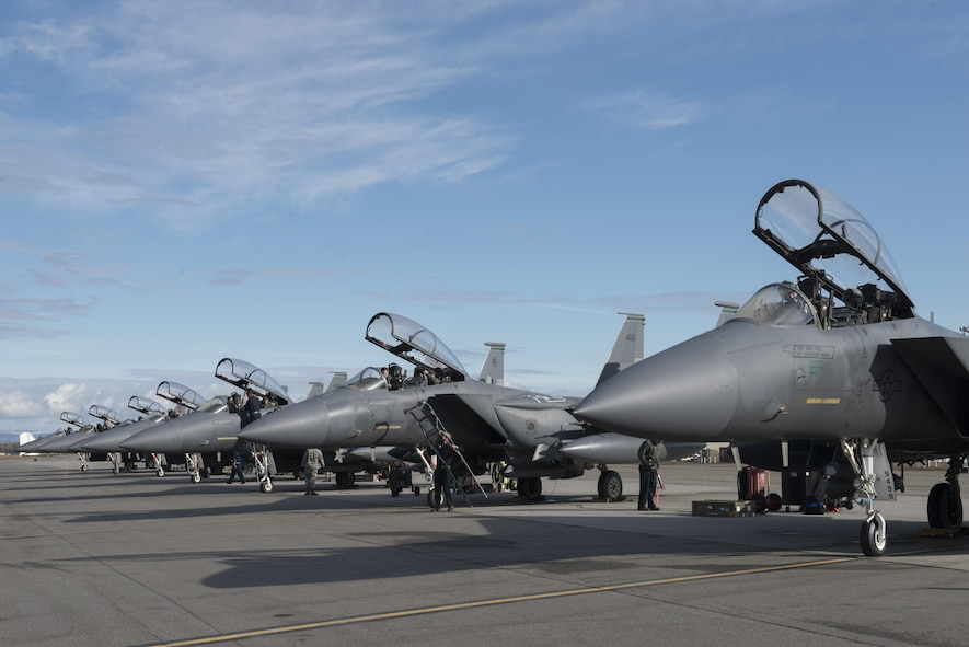 EIELSON AIR FORCE BASE, Alaska – U.S. Air Force pilots assigned to the 335th Fighter Squadron and Airmen assigned to the 335th Aircraft Maintenance Unit, Seymour Johnson Air Force Base, N.C., prepare to launch F15E Strike Eagle dual-role fighter aircraft for a sortie during NORTHERN EDGE 2017 (NE17), May 4, 2017, at Eielson Air Force Base, Alaska. NE17 is Alaska's premier joint training exercise designed to practice operations, techniques and procedures as well as enhance interoperability among the services. Thousands of participants from all the services, Airmen, Soldiers, Sailors, Marines and Coast Guardsmen from active duty, Reserve and National Guard units are involved. (U.S. Air Force photo/Staff Sgt. Ashley Nicole Taylor)