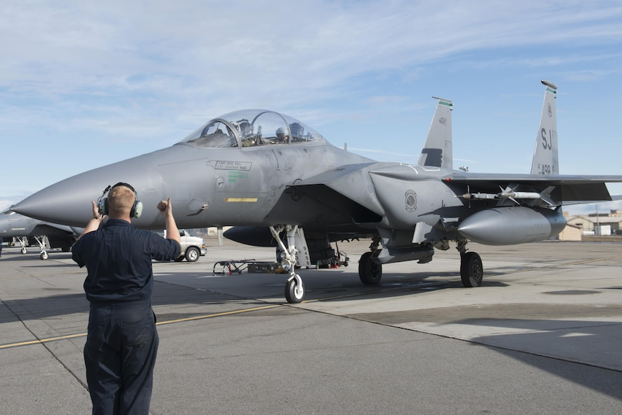 EIELSON AIR FORCE BASE, Alaska – U.S. Air Force Staff Sgt. Brandon Coffman, a 335th Aircraft Maintenance Unit crew chief assigned to Seymour Johnson Air Force Base, N.C., signals to F-15E Strike Eagle dual-role fighter aircraft pilots from the 335th Fighter Squadron, May 4, 2017, during NORTHERN EDGE 2017 (NE17), at Eielson Air Force Base, Alaska. NE17 is Alaska's premier joint training exercise designed to practice operations, techniques and procedures as well as enhance interoperability among the services. Thousands of participants from all the services, Airmen, Soldiers, Sailors, Marines and Coast Guardsmen from active duty, Reserve and National Guard units are involved. (U.S. Air Force photo/Staff Sgt. Ashley Nicole Taylor)