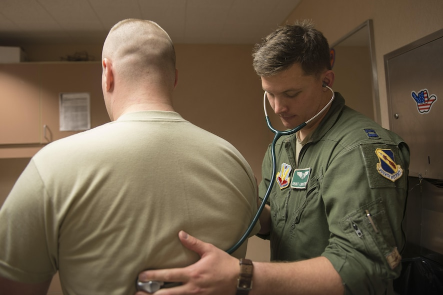 EIELSON AIR FORCE BASE, Alaska – U.S. Air Force Capt. Bret Lindstrom, a 335th Fighter Squadron flight surgeon assigned to Seymour Johnson Air Force Base, N.C., listens to a patient's heartbeat, May 4, 2017, during NORTHERN EDGE 2017 (NE17), at Eielson Air Force Base, Alaska. NE17 is Alaska's premier joint training exercise designed to practice operations, techniques and procedures as well as enhance interoperability among the services. Thousands of participants from all the services, Airmen, Soldiers, Sailors, Marines and Coast Guardsmen from active duty, Reserve and National Guard units are involved. (U.S. Air Force photo/Staff Sgt. Ashley Nicole Taylor)