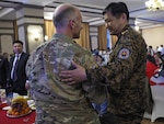"Mongolia National Emergency Management Agency Brig. Gen. Badral Tuvshin (right) greets U.S. Army Maj. Edwin Morton, Gobi Wolf 2017 exercise director and lead U.S. planner, May 1, 2017, during an exercise reception dinner in Dalanzadgad, Mongolia. GW 17 is hosted by the Mongolia National Emergency Management Agency and Mongolian Armed Forces as part of the United States Army Pacific's humanitarian assistance and disaster relief ""Pacific Resilience"" series."