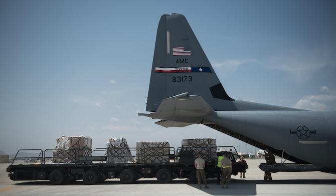 Airmen load cargo onto a C-130J Super Hercules at Bagram Airfield, Afghanistan, May 5, 2017. Deployed out of Dyess Air Force Base, Texas, this C-130J and its support personnel provide tactical airlift, including aeromedical evacuation, cargo and personnel airlift and airdrop--any intra-theater transportation needed to support a successful train, advise and assist mission in Afghanistan. (U.S. Air Force photo by Staff Sgt. Benjamin Gonsier)