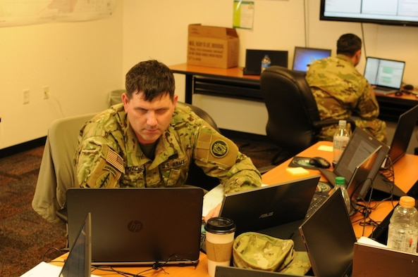 Sgt. James Mitchell, a cyber forensics expert with the Maryland Army National Guard's 110th Information Operations Battalion, performs a network analysis during Exercise Cyber Shield 17 at Camp Williams, Utah, May 1, 2017. (U.S. Air National Guard photo by Lt. Col. Wayde Minami