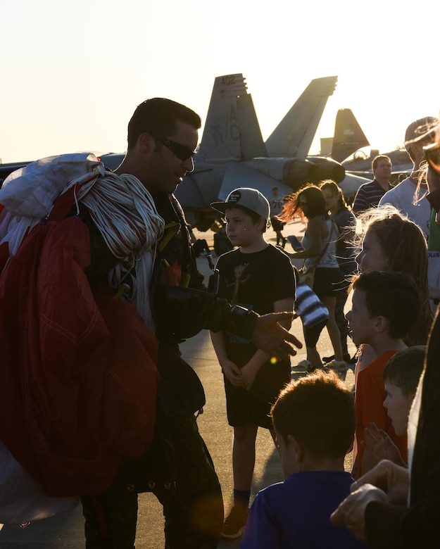 A member of the Canadian Skyhawks parachute team meets and greets spectators during the 2017 Defenders of Liberty Air Show at Barksdale Air Force Base, La., May 5, 2017. The SkyHawks are Canada's only military parachute demonstration team. For over 40 years, they have represented Canada and the Canadian Armed Forces to over 75 million spectators worldwide under their signature Canadian flag parachutes. (U.S. Air Force photo/Senior Airman Luke Hill)