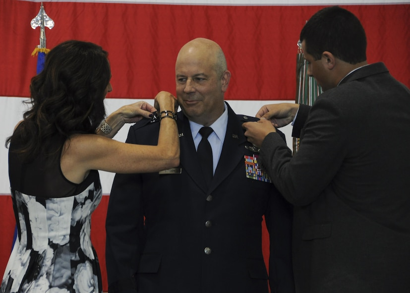 The 442d Fighter Wing Commander Brig. Gen. Brian Borgen's wife and son pin on his new rank during his promotion ceremony at Whiteman Air Force Base, Mo., May 6, 2017. Borgen commands approximately 1,300 Air Force reservists and 24 A-10 Thunderbolt II aircraft at Whiteman AFB and the 476th Fighter Group, a geographically separated unit located at Moody AFB, Ga. (U.S. Air Force photo by Senior Airman Missy Sterling)