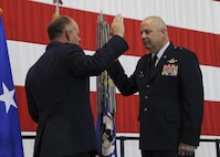 Brig. Gen. Brian Borgen, the commander of the 442d Fighter Wing, takes the oath of office during his promotion ceremony at Whiteman Air Force Base, Mo., May 6, 2017. Borgen has earned numerous medals and awards for his achievements, including the Legion of Merit and the Bronze Star. (U.S. Air Force photo by Senior Airman Missy Sterling)