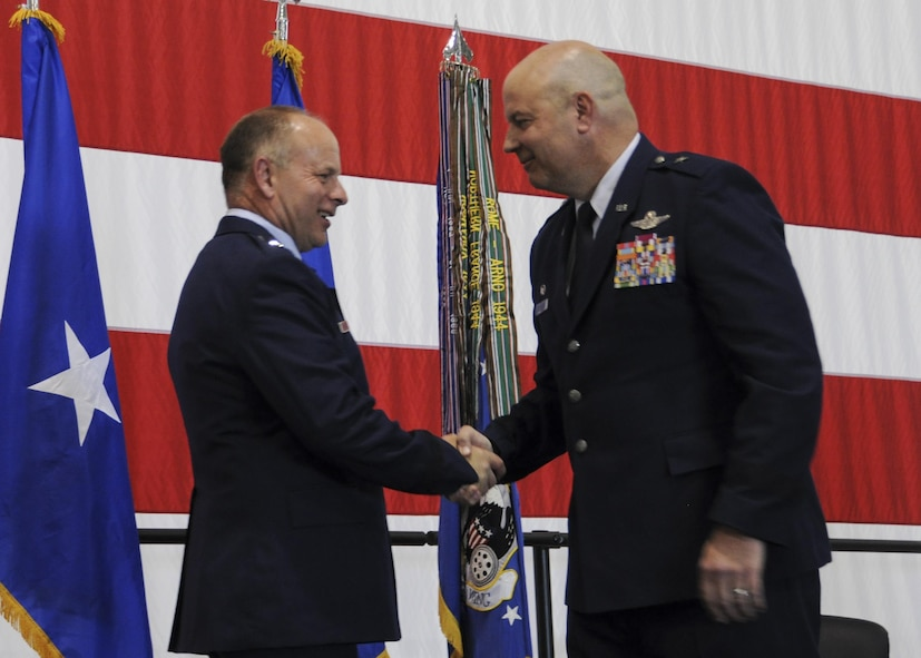 Brig. Gen. James F. Mackey, the Mobilization Assistant to the Director of Operations, Joint Base Langley-Eustis, Va., congratulates Brig. Gen. Brian Borgen, the 442d Fighter Wing Commander, during his promotion ceremony at Whiteman Air Force Base, Mo., May 6, 2017. Borgen met Mackey while he was a cadet at Kansas State University in the early 1990s. (U.S. Air Force photo by Senior Airman Missy Sterling)