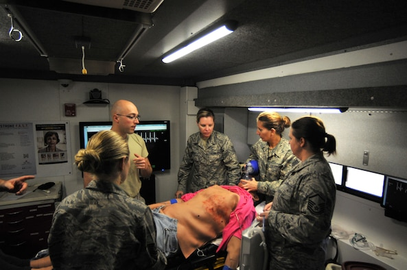 Tech. Sgt. Rachel Vanbeek, 114th Medical Group, aerospace medical technician, assigned tasks to her trauma team during a simulated medical emergency inside the Simulation in Motion South Dakota (SIMSD) vehicle at Joe Foss Field May 6, 2017.  SIMSD was on base to provide highly realistic simulations for the 114th Medical Group medics.  The SDNG will continue to maintain ready and reliable units, and have equipment and facilities, which support both federal and state missions.  (U.S. Air National Guard photo by Master Sgt. Christopher Stewart/Released)