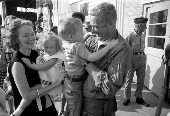 Iowa Air National Guard Captain, John Haley an F-100 fighter pilot with the 185th Tactical Fighter Group is greeted by his family in Sioux City, Iowa on May 14, 1969 after returning home from the war in Vietnam. Haley and the rest of the 185th are returning home from yearlong duty at Phu Cat Airbase in South Vietnam. (U.S. Air National Guard photo/released 185th TFG Photo)