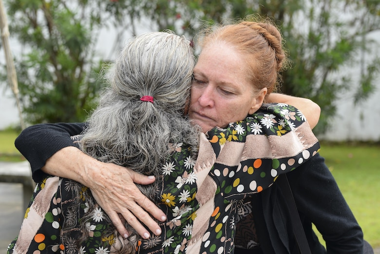 Patricia Gay, 734th Air Mobility Squadron, embraces a friend during Lt Col. (Ret.) Chuck McManus' funeral at the Guam Veterans Cemetery April 26, 2017, in Piti, Guam. McManus was a key figure at Andersen Air Force Base due to his involvement during the Linebacker II campaign during the Vietnam War. (U.S. Air Force photo by Airman 1st Class Christopher Quail)