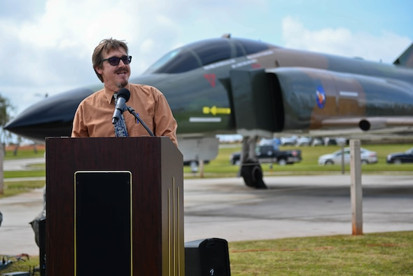 Jeffrey Meyer, 36th Wing Historian, speaks at the F-4E Phantom II Rededication Ceremony, April 21, 2017, at Andersen Air Force Base, Guam. The Phantom II was first deployed to the Pacific Air Forces in December 1964, in support of the Vietnam War. (U.S. Air Force photo by Airman 1st Class Christopher Quail/Released)