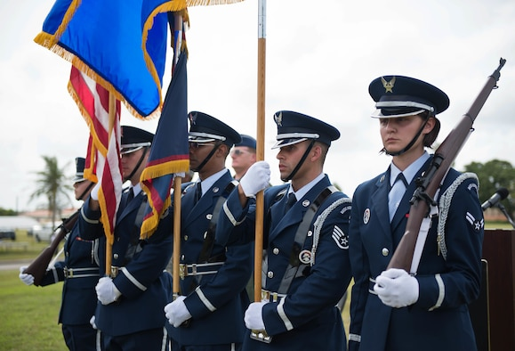 The Andersen Blue Knights Honor Guard team presents the colors during the F-4E Phantom II Rededication Ceremony, April 21, 2017, at Andersen Air Force Base, Guam. The Phantom II was first deployed to the Pacific Air Forces in December 1964, in support of the Vietnam War. (U.S. Air Force photo by Airman 1st Class Christopher Quail/Released)