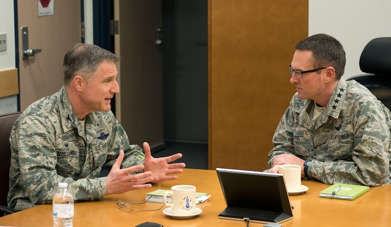 National Guard Bureau Chief Gen. Joseph L. Lengyel (right), the ranking officer in the U.S. National Guard, discusses Alaska Air National Guard capabilities with Col. Steven deMilliano, commander of the Alaska Air National Guard's 176th Wing, here May 7, 2017. Lengyel visited the wing as part of a wider tour of Alaska National Guard installations. While here, he met with the wing's senior leaders, toured maintenance facilities, and met and fielded questions from Airmen of all ranks.