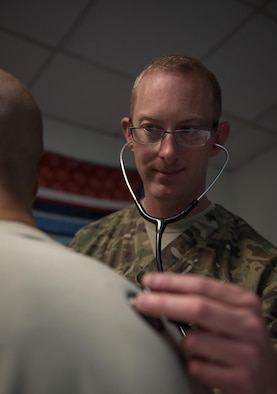 U.S. Air Force Capt. James Dunham, an intensive care ward nurse at Craig Joint Theater Hospital, checks the vitals of a patient at Bagram Airfield, Afghanistan, May 3, 2017. As a nurse, Dunham is the link between the patient and doctor. They are responsible for ensuring medicine is administered, pain is managed and attending to the patient in any way they can. (U.S. Air Force photo by Staff Sgt. Benjamin Gonsier)