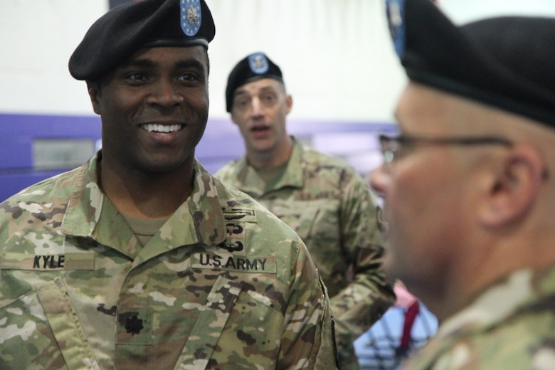 Army Lt. Col. Clifton C. Kyle, commander of the 457th Civil Affairs Battalion , 361st CA Brigade, 7th Mission Support Command, talks to Soldiers of his new unit after a change of command ceremony held at the Field House, Tower Barracks, United States Army Garrison, Bavaria on May 7, 2017.