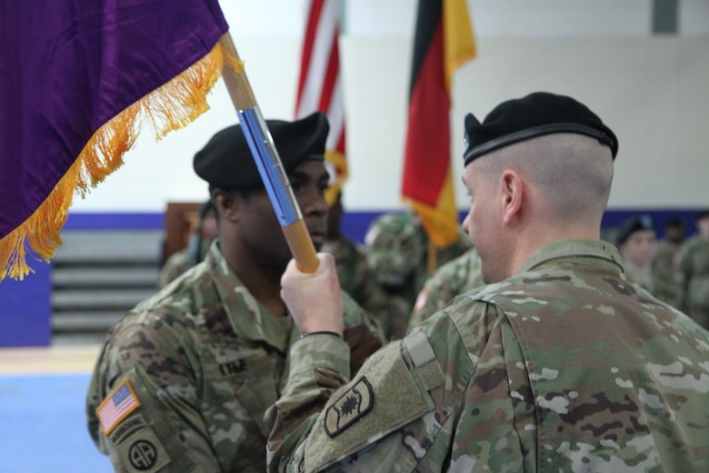 Army Lt. Col. Clifton C. Kyle (left), commander of the 457th Civil Affairs Battalion , receives the unit guidon from Col. John T. Novak, commander of the 361st CA Brigade, 7th Mission Support Command in a change of command ceremony held at the Field House, Tower Barracks, United States Army Garrison, Bavaria on May 7, 2017.