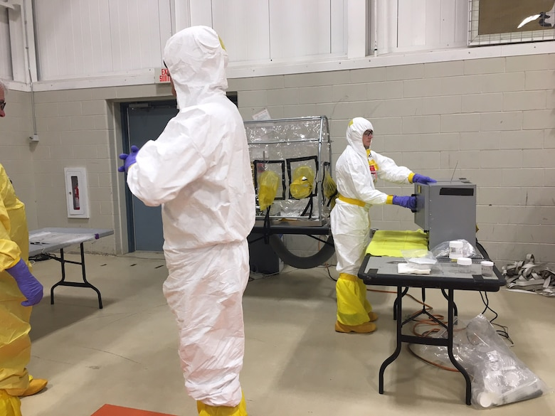 Technicians prepare simulated nuclear debris samples collected during Prominent Hunt 17-1, a combined counterterrorism exercise between the United States and Canada April 24-28, 2017.  The exercise collectively tested each nation's ability to respond to two simulated nuclear post-detonation attacks..  (Photo courtesy of the Department of Homeland Security)