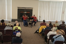 """On May 7, 2017 the Marine Band performed a concert called """"Arioso"""" which highlighted music inspired by the connection between the human voice and instruments. Featured selections included Joseph Schwantner's and the mountains rising nowhere and James Stephenson's Symphony No. 2, Voices. A guitar/violin duo gave a pre-concert performance in the lobby. (U.S. Marine Corps photo by Master Sgt. Kristin duBois/released)"""