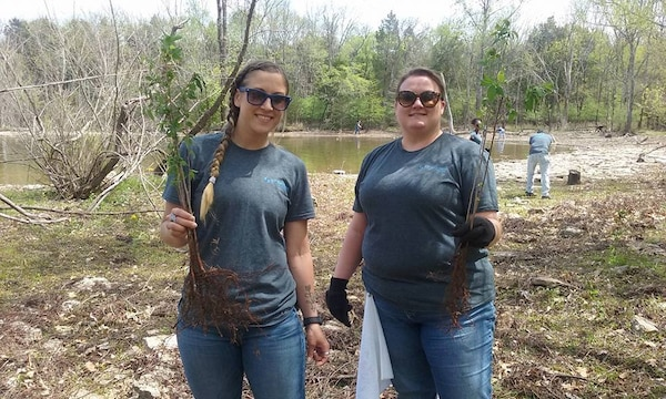 Stephanie Bury and LeAnn Powers both volunteers from VF Imagewear, Inc., plant trees during a lake clean up at the Cook Recreation Area at the J. Percy Priest Lake on April 13, 2017.