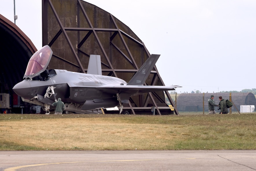 An F-35A Lightning II pilot from the 34th Fighter Squadron, assigned to Hill Air Force Base, Utah, greets maintenance Airmen prior to a flight from Royal Air Force Lakenheath, England, May 7. The F-35A is a fifth generation fighter that provides the joint warfighter unprecedented global precision attack capability against current and emerging threats, while complementing the Air Force's air superiority fleet. (U.S. Air Force photo/Airman 1st Class John A. Crawford)