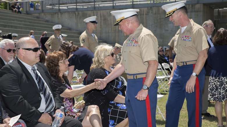 Col. Joseph Russo, command officer of 14th Marine Regiment, 4th Marine Division, along with Col. Jeffrey Smitherman, commanding officer for 6th Marine Recruiting District, greet the family members of Gunnery Sgt. Thomas Sullivan and Staff Sgt. David Wyatt, at Ross's Landing in Chattanooga, Tenn., May 7, 2017. Sullivan and Wyatt were posthumously awarded the medal for their actions during the July 16, 2015 shooting that occurred at the Naval Reserve Center Chattanooga that left two other Marines and a sailor dead.