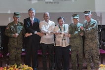 "Armed Forces of the Philippines Lt. Gen. Oscar T. Lactao, left, The Honorable Ambassador Sung Y. Kim, Secretary Delfin N. Lorenzana, Under Secretary Ariel Y. Abadilla, AFP Gen. Edruardo M. Año, and U.S. Marine Lt. Gen. Lawrence D. Nicholson stand ""shoulder-to-shoulder"" and shake hands during the opening ceremony for Balikatan 2017 at Camp Aguinaldo, Quezon City, May 8, 2017. Lactao is the Philippine exercise director for Balikatan. Kim is the U.S. Ambassador to the Philippines. Lorenzana is the Philippine Secretary of National Defense. Abadilla is the Philippine Undersecretary for Civilian Security and Consular Concerns. Año is the Chief of Staff of the AFP. Nicholson is the commanding general of III Marine Expeditionary Force. Balikatan is an annual U.S.-Philippine bilateral military exercise focused on a variety of missions including humanitarian and disaster relief, counterterrorism, and other combined military operations."