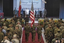 Philippine and U.S. color guards present the colors during the Balikatan 2017 opening ceremony at Camp Aguinaldo, Quezon City, May 8, 2017. Balikatan is an annual U.S.-Philippine bilateral military exercise focused on a variety of missions including humanitarian and disaster relief, counterterrorism, and other combined military operations.