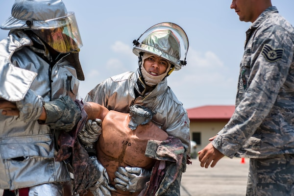 A firefighter from Central America participate in a timed event after learning new techniques during Central America Sharing Mutual Operational and Experience at Joint Task Force – Bravo, Apr. 25, 2017. CENTAM SMOKE is a biannual exercise hosted by Joint Task Force – Bravo with 35 participants from across the 7 Central America nations that includes safety, personal protective equipment, apparatus familiarization, fire hose applications, structural/helicopter live fire evolutions, medical training, vehicle extrication, and aircraft (UH–60/CH–47) egress familiarization, Apr. 24-28, 2017. (U.S. Air National Guard photo by Master Sgt. Scott Thompson/released)
