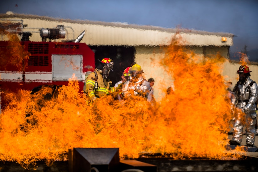 Firefighters from Central America learn new fire hose techniques at a live fire exercise during Central America Sharing Mutual Operational and Experience at Joint Task Force – Bravo, Apr. 26, 2017. CENTAM SMOKE is a biannual exercise hosted by Joint Task Force – Bravo with 35 participants from across the 7 Central America nations that includes safety, personal protective equipment, apparatus familiarization, fire hose applications, structural/helicopter live fire evolutions, medical training, vehicle extrication, and aircraft (UH–60/CH–47) egress familiarization, Apr. 24-28, 2017. (U.S. Air National Guard photo by Master Sgt. Scott Thompson/released)