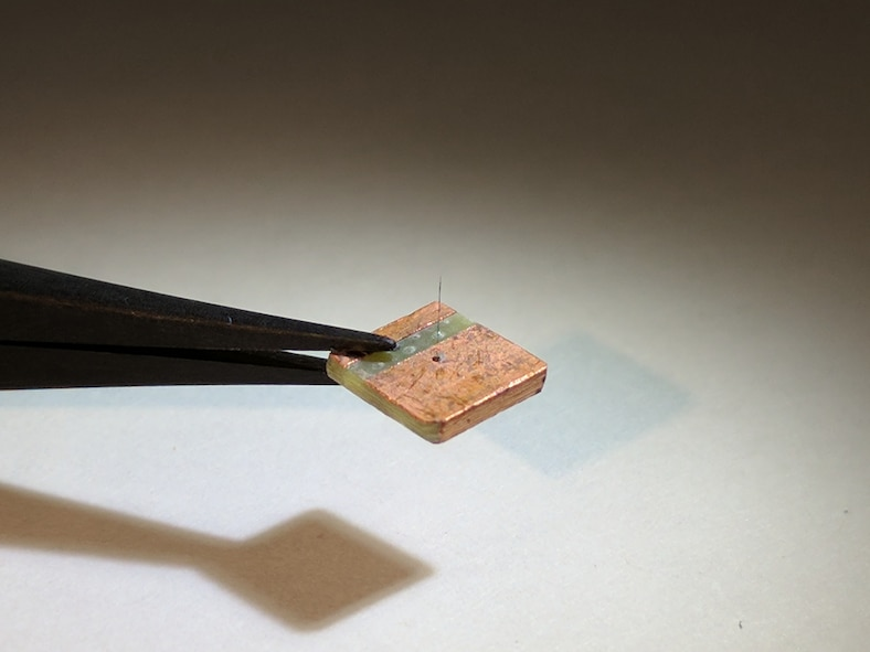 Researchers at the Materials and Manufacturing Directorate, Air Force Research Laboratory, have developed a novel, lightweight artificial hair sensor that mimics those used by natural fliers—like bats and crickets—by using carbon nanotube forests grown inside glass fiber capillaries. The hairs are sensitive to air flow changes during flight, enabling quick analysis and response by agile fliers. (Air Force courtesy photo).