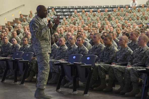 Chief Master Sgt. of the Air Force Kaleth O. Wright delivers a speech to Airmen from