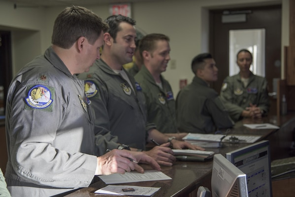 Members of the 39th Flying Training Squadron receive a pre-flight briefing May 4, 2017, at Joint Base San Antonio-Randolph, Texas during the Cobras in the Clouds exercise. The exercise gave 39th FTS members a chance to practice their war-time mission of taking control of the training mission of the 12th Operations Group. (U.S. Air Force photo by Senior Airman Stormy Archer)