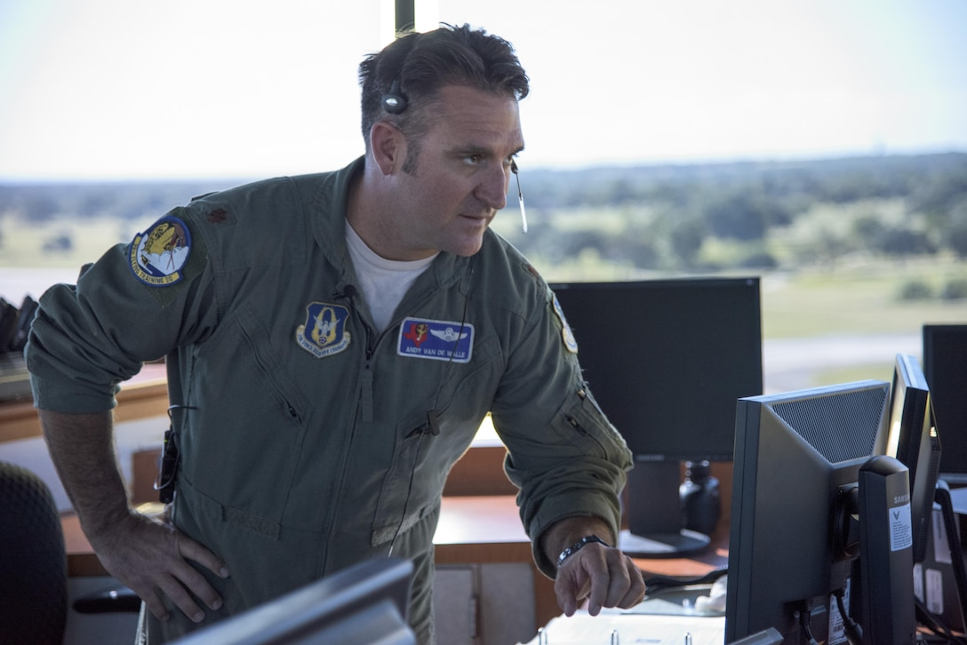 Maj. Andrew Van De Walle, 39th Flying Training Squadron instructor pilot supervises flight control tower operations May 4, 2017, at Joint Base San Antonio-Randolph during the Cobras in the Clouds exercise. The exercise gave 39th FTS members a chance to practice their war-time mission of taking control of the training mission of the 12th Operations Group. (U.S. Air Force photo by Senior Airman Stormy Archer)