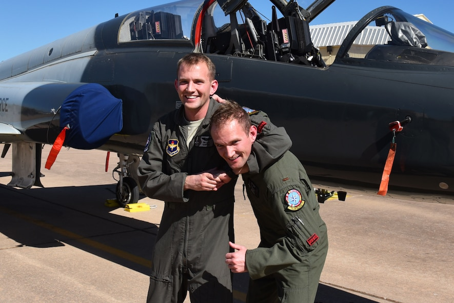Identical twins 2nd Lt. Traverse Garvin and 2nd Lt. Dillon Garvin approach the end of their time at Sheppard Air Force Base, Texas, March 3, 2017. Their healthy sibling rivalry has helped them achieve their dream of becoming U.S. Air Force fighter pilots. (U.S. Air Force photo by 2nd Lt. Jacqueline Jastrzebski)