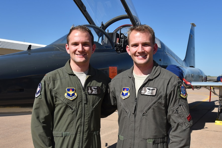 Identical twins 2nd Lt. Traverse Garvin and 2nd Lt. Dillon Garvin approach the end of their time at Sheppard Air Force Base, Texas, March 3, 2017. The brothers will continue their careers by learning to fly the F-22 Raptor at Tyndall Air Force Base, Florida. (U.S. Air Force photo by 2nd Lt. Jacqueline Jastrzebski)