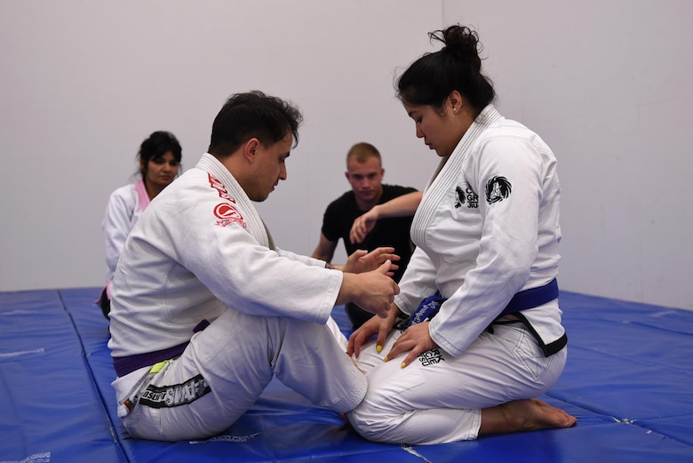 Staff Sgt. Peter Beyer, 19th Civil Engineer Squadron firefighter, and Letia Eclavea, University of Maryland University College student, instruct their students on Brazilian Jiu Jitsu grappling techniques April 24, 2017, at the Fitness Center on Little Rock Air Force Base, Ark. Beyer and Enclavea share a passion for Brazilian Jiu JItsu and host free training classes, 6—7:30 p.m., Monday—Thursday. (U.S. Air Force photo by Airman 1st Class Kevin Sommer Giron)